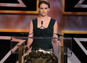 Actress Alice Eve on stage speaking during the Britannia Awards ceremony