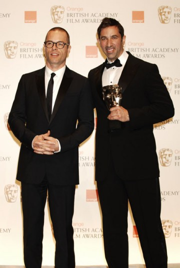 Guy Pearce stands with Sheldon Turner after presenting him with the Adapted Screenplay award (BAFTA/Richard Kendal).