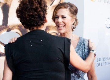 Rita Wilson greeting Donna Langley of NBC Universal