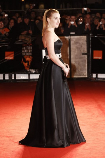 The British actress opted for a classic, black strapless gown by her favourite designer, Ben De Lisi, with a Swarovski crystal belt. (pic: BAFTA/Richard Kendal)