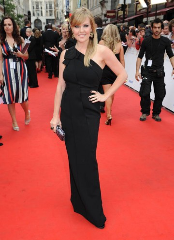 She looks effortlessly stylish in this long, black evening dress. It has enough structure to show her great hourglass figure, and the one-shoulder neckline brings a classic style dress up to date. Black is such a great colour, as it always looks chic and