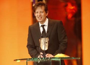 Slumdog Millionaire's producer Christian Colson accepts the Best Film BAFTA, the film's seventh BAFTA of the night (BAFTA / Marc Hoberman).