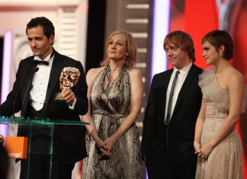 "Harry Potter producer David Heyman and creator JK Rowling with stars Emma Watson and Rupert Grint. ""We've had the privilege of working with some of the finest people working today; in an atmosphere filled with pride, but with no ego,"" said Heyman. (Pic: B"