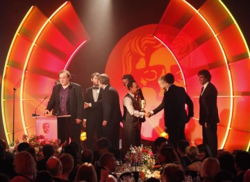 Nigel Heath, Alex Sawyer, Adam Armitage, Mark Holding collect the award for their work on sound in Downton Abbey. (Pic: BAFTA/Jamie Simonds)