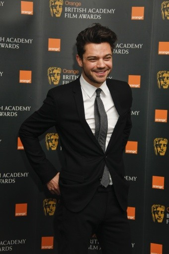 Dominic Cooper grins for the cameras at the nominations press conference.