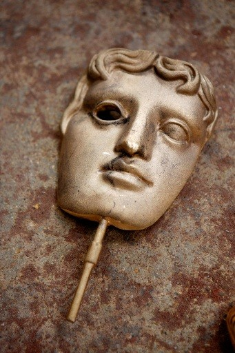 The moulds are allowed to cool before the masks are broken free and the rough edges filed down (BAFTA / Marc Hoberman).