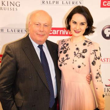 Downton Abbey creator Julian Fellowes with actress Michelle Dockery on the red carpet at a Downton Abbey Sneak Preview and Q&A event in New York.