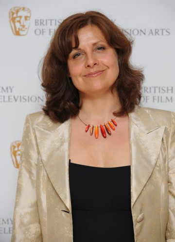 The Thick Of It star Rebecca Front poses for the waiting press before presenting the Editing Fiction Award.
