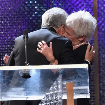 Honoree Dame Judi Dench (R) accepts the 2014 Albert R. Broccoli Britannia Award for Worldwide Contribution to Entertainment from actor Dustin Hoffman
