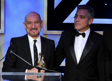 Sir Ben Kingsley and George Clooney on stage after accepting their Britannia Awards