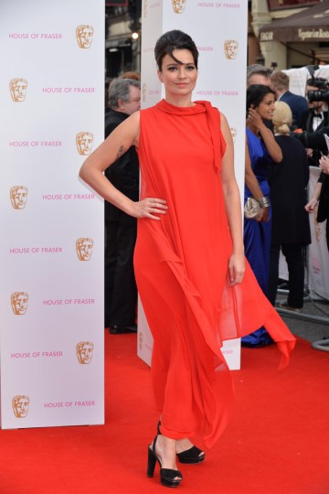 Gizzi Erskine strikes a pose on the red carpet. Tanning and skin finnishing by St Tropez, make up by MAC