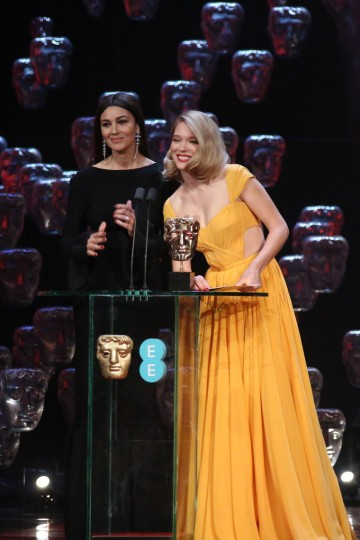 Lea Seydoux and Monica Belluci take to the stage to present the awards for Makeup and Hair and Production Design