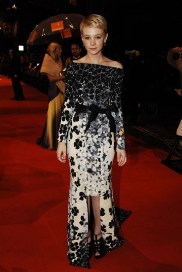 Lead Actress nominee for An Education, Carey Mulligan, elegantly wears a long black and white floral Vionnet dress (BAFTA/Richard Kendal).