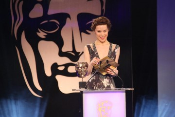 Andrea Deck presents the award for Artistic Achievement at the British Academy Games Awards Ceremony in 2015