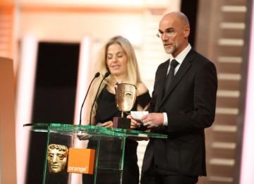 Valli O'Reilly and Paul Gooch pick up the BAFTA for their distinctive work in Alice In Wonderland. (Pic: BAFTA/ Stephen Butler)