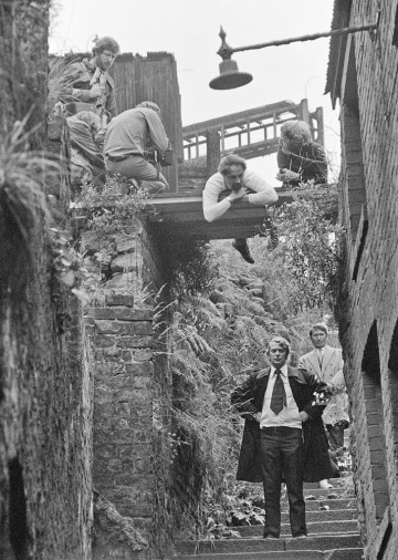 Lining up a shot of Micheal Caine on the filmset of Get Carter (1971).  On the bridge are Mike Hodges, Director and operator Dusty Miller.