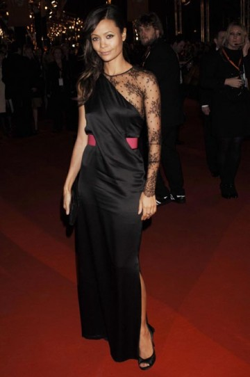 Thandie Newton arrived in an off-the-shoulder, satin black dress by designer Alexander McQueen with Jimmy Choo shoes. She carried a Louboutin bag and wore Azagury Partridge jewellery (pic: BAFTA / Richard Kendal).