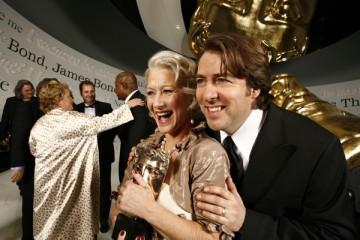 Academy winner Helen Mirren shows off her Actress Award with the ceremony host, Jonathan Ross (BAFTA).