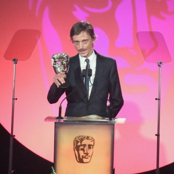 Mackenzie Crook accepts the award for Writer: Comedy at the British Academy Television Craft Awards in 2015