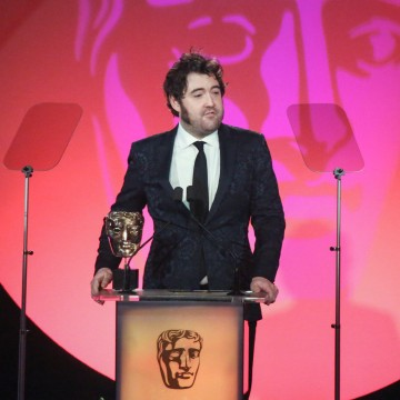 Nick Helm Presents the award for Original Music sponsored by The Farm at the British Academy Television Craft Awards in 2015, won by Abel Korzeniowski