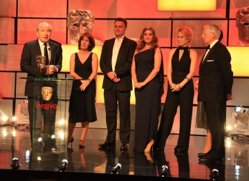 The winning team, including Lord  Sugar, Nick Hewer, Karen Brady, Michele Kurland, Colm Martin, Darina Healy and Andy  Devonshire.