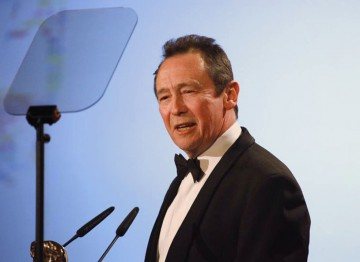 The well loved actor, writer and comedian presents the award for Entertainment Craft Team. (Pic: BAFTA/Jamie Simonds)
