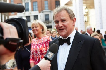 Hugh Bonneville, nominee in the Male Performance in a Comedy Programme category, is interviewed on the red carpet