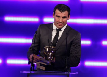 "The former boxer, described by Ricky Hatton as ""the best British fighter we've ever had"" announces this year's Sports winner.  (Pic: BAFTA/Brian Ritchie)"