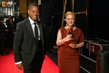 Supporting Actress presenter Cuba Gooding Jnr backstage with award winner Patricia Arquette at London's Royal Opera House.