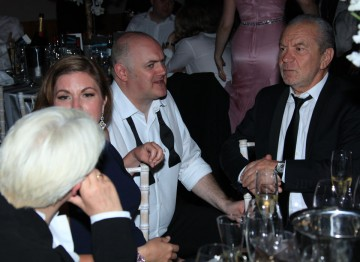 Dara O'Briain and Alan Sugar are deep in discussion at the Television Awards After Party.