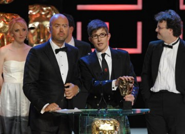Jamie Isaacs, Henry Beney and Rob McCabe took to the stage with choirmaster Gareth Malone to collect the Features award for their documentary following a boys school choir in Lancaster (BAFTA / Marc Hoberman).