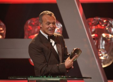 Graham Norton switches temporarily from ceremony host to gracious winner.