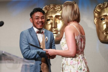 Filmmaker Drama Del Rosario accepts the BAFTA-GSA Commissioning Grant