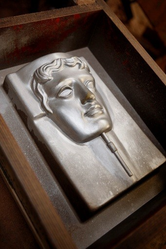 Once filled with the bronze alloy the moulds take about forty minutes to cool down (BAFTA / Marc Hoberman).