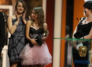 Molly Windsor and Lauren Socha collect the Single Drama BAFTA for Samanttha Morton's directorial debut The Unloved. (BAFTA/Steve Butler)