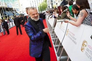 Host Graham Norton meets fans outside London's Theatre Royal