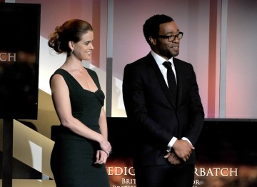 Alice Eve and Chiwetel Ejio watch on as Benedict Cumberbatch delivers his acceptance speech