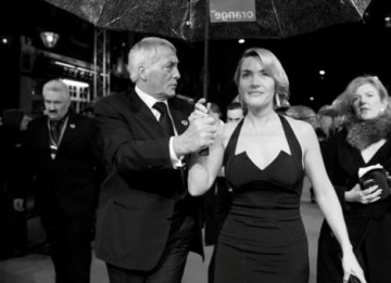Kate Winslet is escorted on the Red Carpet moments before she is awarded with BAFTA for Leading Actress (Greg Williams / Art+Commerce).