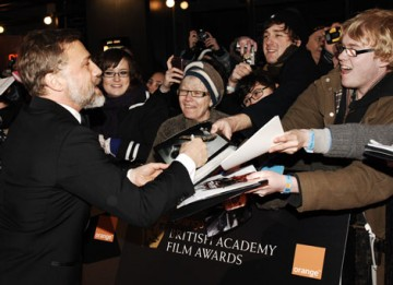 The glorious Christoph Waltz signs autographs for fans on the red carpet (BAFTA/Richard Kendal).