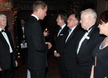 BAFTA Chairman Tim Corrie watches on as the Duke of Cambridge greets Nigel Lythgoe, John Willis, Brian Walton and Rebecca Segal