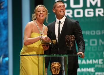 Eastenders stars Laurie Brett and John Partridge present the BAFTA for Comedy Programme. (BAFTA/Steve Butler)