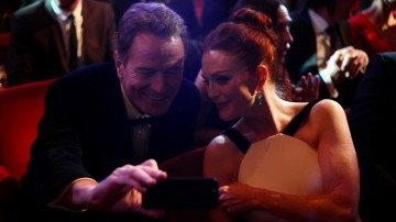 Bryan Cranston and Julianne Moore take a selfie whilst waiting for the ceremony to begin