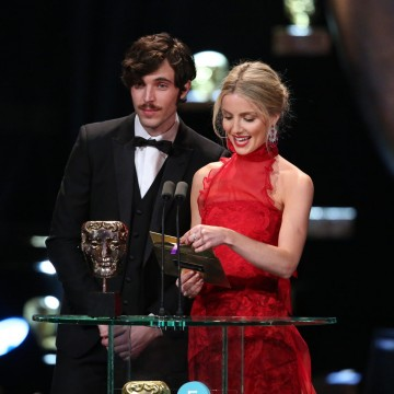 Annabelle Wallis and Tom Hughes present the awards for Make Up & Hair and Cinematography