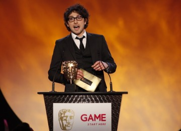 Presenter Alex Zane announces the nominees up for an award in the Gameplay category (BAFTA/Brian Ritchie)