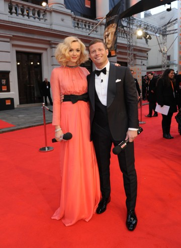 Hosting E!'s red carpet coverage are Radio One DJ Cotton and The X Factor's O'Leary. Fearne is pictured here in a gown by Moschino and Dermot O'Leary in a suit by Tom Sweeney.