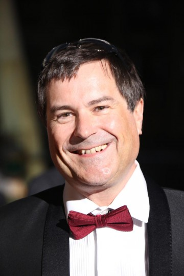 David Braben arrives on the red carpet ahead of his BAFTA Fellowship award
