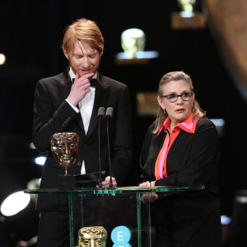 Domhnall Gleeson and Carrie Fisher present the award for Film Not in the English Language at the 2016 EE British Academy Film Awards