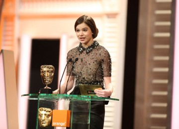 True Grit star and Leading Actress nominee Hailee Steinfeld announces the Make Up & Hair winner. (Pic: BAFTA/Stephen Butler)