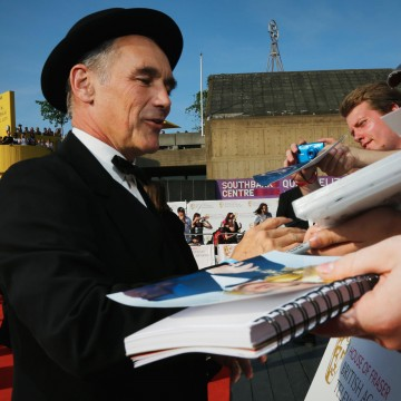 Leading Actor winner Mark Rylance signs autographs for waiting fans