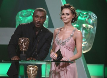 Kara Tointon and Ashley Walters step up to present the Drama Serial award.
